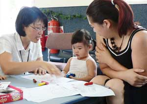 Migrant Resource Centre worker with parent and child
