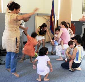 Playgroup parents and children bobbing up and down